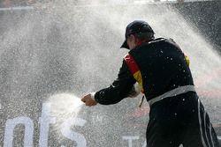 Podium: Nico Hulkenberg sprays champagne