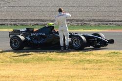 Jenson Button stopped on track