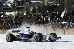 Nick Heidfeld drives a BMW Sauber F1 on the St Moritz horse racing on special spike tyres from Bridg