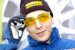 Mikko Hirvonen wears shades to shield against the winter conditions
