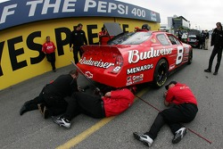 The Bud Chevy crew work on the #8 car at tech inspection