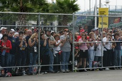 Fans watch drivers as they head to pitlane