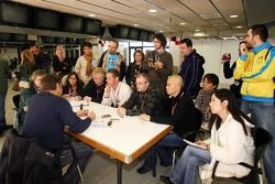 Co-owner Gerhard Berger with journalists