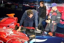 Race engineer Riccardo Adami, co-owner Gerhard Berger and Vitantonio Liuzzi with the new STR2