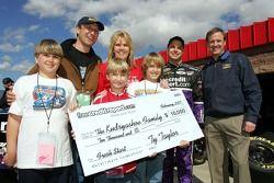 David Gilliland and Rusty Wallace present a check to a Hurricane Katrina Family