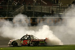 Race winner Mike Skinner performs a burnout