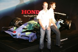 Jenson Button and Rubens Barrichello with the Honda F1 Racing RA107 in its new livery