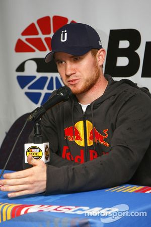 Brian Vickers speaks with the media after rain began to fall