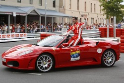 Marc Gene, test driver, Scuderia Ferrari, waves to the fans