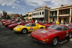 Historic Ferrari road cars lined up for the street parade