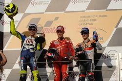 Podium: racewinnaar Casey Stoner met Valentino Rossi en Dani Pedrosa