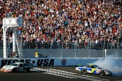 Jeff Burton takes the checkered flag as 2nd place finisher Kyle Busch slides sideways across the lin