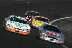 Jeff Burton and Kyle Busch battle for the lead