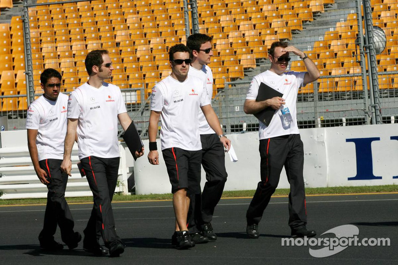 Fernando Alonso, McLaren Mercedes, walks round the circuit