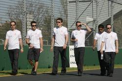 Fernando Alonso, McLaren Mercedes, walks around the circuit with his team