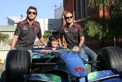 Jenson Button, Honda Racing F1 Team and Rubens Barrichello, Honda Racing F1 Team, visit a local school to promote Energy conservation