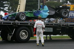 Rubens Barrichello, Honda Racing F1 Team, watches his car being lifted onto the back of a truck