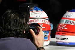 A photographer shoots the helmets of Jenson Button, Honda Racing F1 Team and Rubens Barrichello, Honda Racing F1 Team