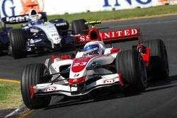 Anthony Davidson, Super Aguri F1 Team, SA07 and Nico Rosberg, WilliamsF1 Team, FW29