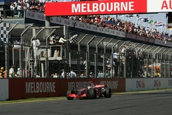 Fernando Alonso, McLaren Mercedes, MP4-22 takes the chequered flag