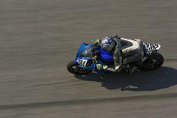 David Mcpherson takes his Yamaha YZF R6 through Daytona's high bank on turn 4