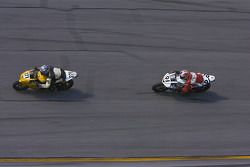 Jeffery Tigert (91) tries to keep up with Steve Breckenridge (271) who's racing the only Triumph motorcycle registered at the 2007 Honda 200 at Daytona Intn'l Speedway