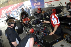 Eric Medlen (cockpit) helps ready his Funny Car as his father and crew chief, John Medlen also dons