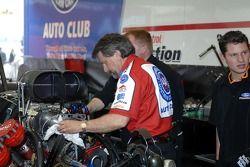 John Medlen crew chief works on son Eric Medlen's Funny Car
