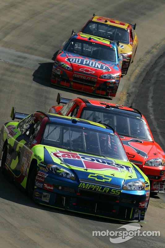 Kyle Busch leads Jeff Burton in the last lap