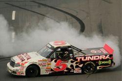 Race winner Mike Skinner celebrates