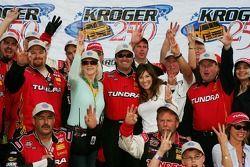 Victory lane: race winner Mike Skinner celebrates
