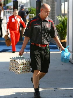Honda Racing F1 Team personnel carrying a box of eggs