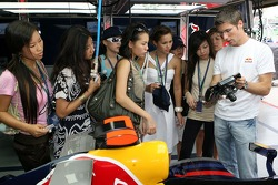 Formula Unas girls: Zhang Jia, Fay, Sally Wong, Vaune Phan, Claire-Louise Jedrek, Cara Chew, Angeline Ting, Alexandra Hui and test driver Michael Ammermueller