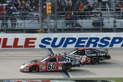 Carl Edwards battles Jason Leffler for the lead