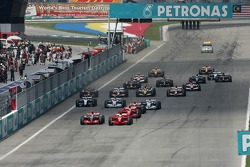 Start: Fernando Alonso, McLaren Mercedes, MP4-22 and Felipe Massa, Scuderia Ferrari, battle for the lead