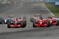 Start: Fernando Alonso, McLaren Mercedes, MP4-22 and Felipe Massa, Scuderia Ferrari, battle for the