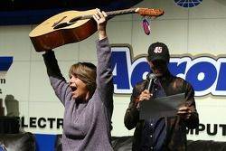 A view of a fan holding up a guitar that she won as a door prize, during the Fandango Exclusive Seas