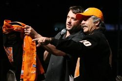 Tony Stewart hands out a jacket as a door prize to a fan, during the Fandango Exclusive Season Ticket Holders party
