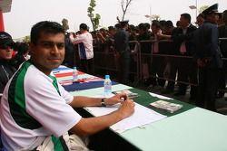 Autograph session: Nur Ali, Driver of A1Team Pakistan