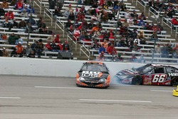 Brent Sherman spins in front of Steven Wallace