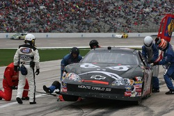 Stanton Barrett's crew work on the car