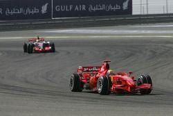 Felipe Massa, Scuderia Ferrari, F2007 and Lewis Hamilton, McLaren Mercedes, MP4-22