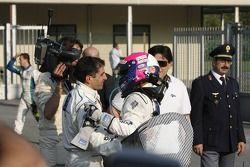 Marc Gene célèbre sa victoire avec Pedro Lamy