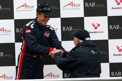 Podium: Robbie Kerr, Driver of A1Team Great Britain and John Surtees, Team Manager of A1Team Great Britain