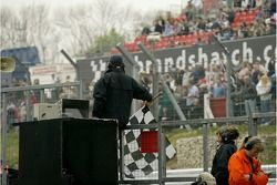 The chequered flag is waved to finish the A1 GP Sprint race at Brands Hatch declaring A1 Team Great