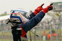 A1 Team Great Britain driver Robbie Kerr celebrates his victory in the A1 GP sprint race at Brands Hatch