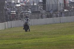 Mat Mladin encourages the crowd to cheer even louder after winning Sunday's Superbike Race at California Speedway