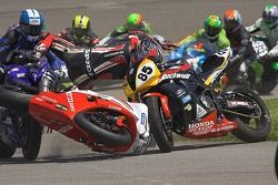 David Anthony is thrown from his Yamaha at the start of Sunday's Supersport Race at California Speedway