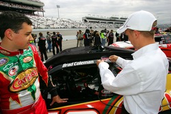 Brad Coleman watches Billy Banson, as he puts on a Virginia Tech University sticker on the car