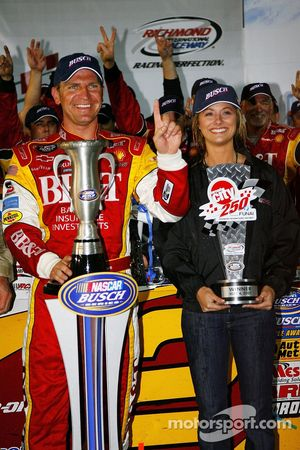 Victory lane: race winner Clint Bowyer celebrates with his girlfriend Athena Barber